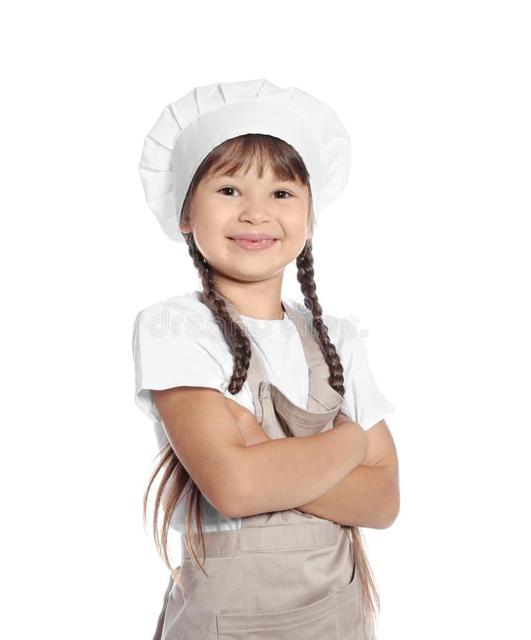 Portrait of little girl in chef hat. On white background royalty free stock photo