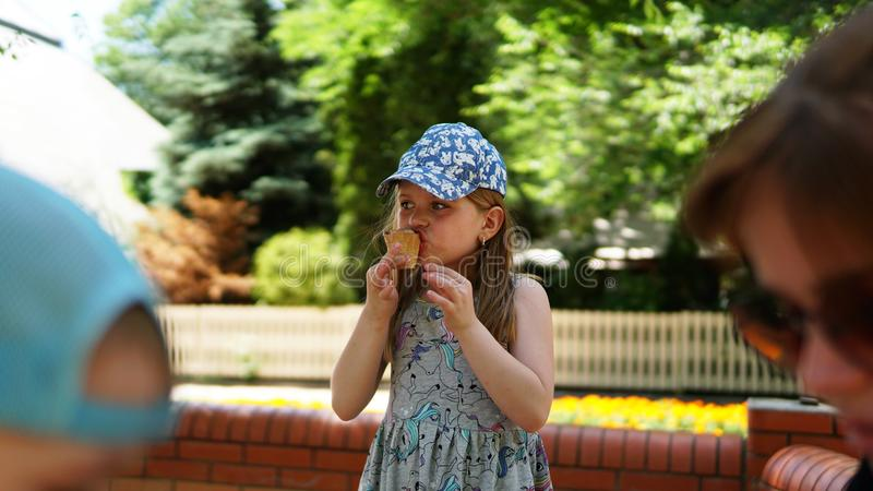 Portrait of a little girl . A child in the Park with ice cream stock photography