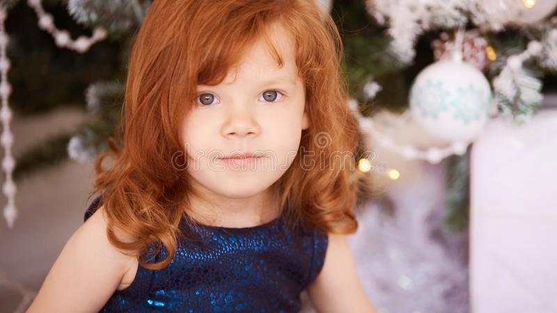Portrait of little girl. Christmas interior. Red hair. Horizonta royalty free stock images