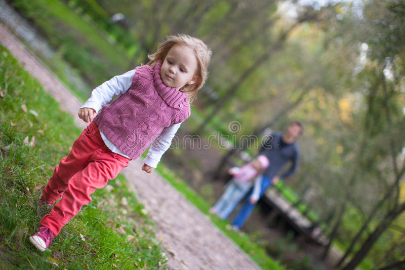 Portrait of little girl close-up and her father royalty free stock photos