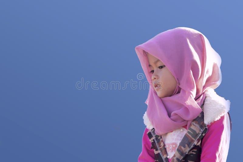 Portrait of a little girl. Closeup blue background stock image