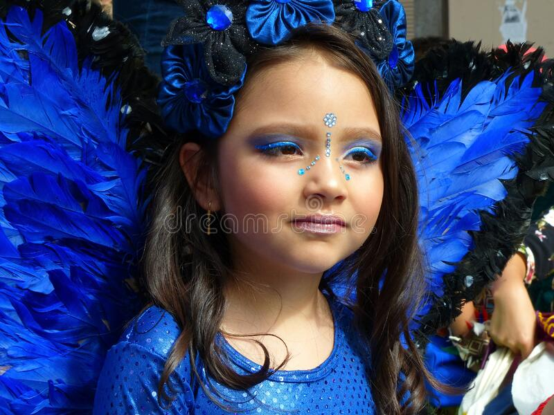 Portrait of little girl dressed as blue butterfly stock image