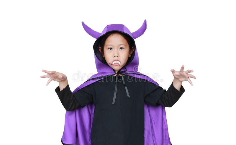 Portrait little girl dressed Halloween costume with face make up. Kid in Dracula robe with frightening expression isolated on. White background royalty free stock images