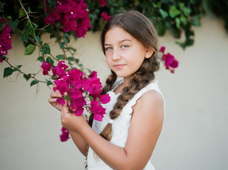 Portrait of a little girl with flowers stock photos