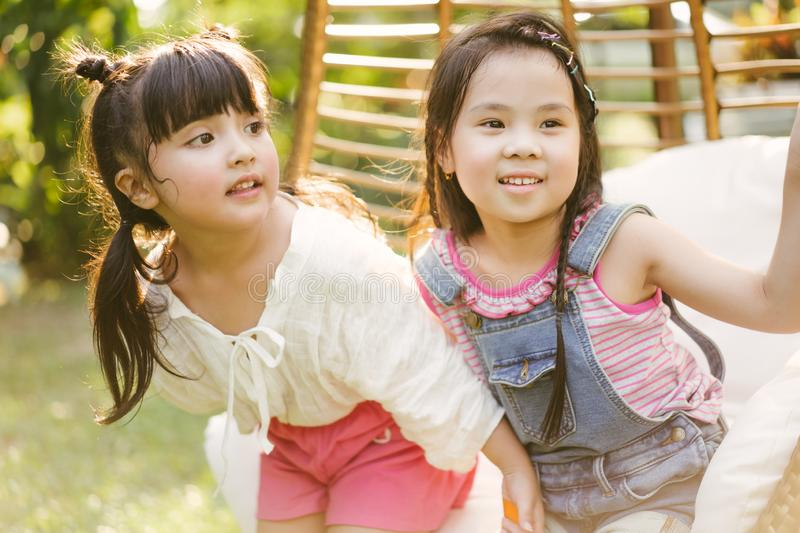 Portrait little girl with friends. cute kid in nature park. royalty free stock photography