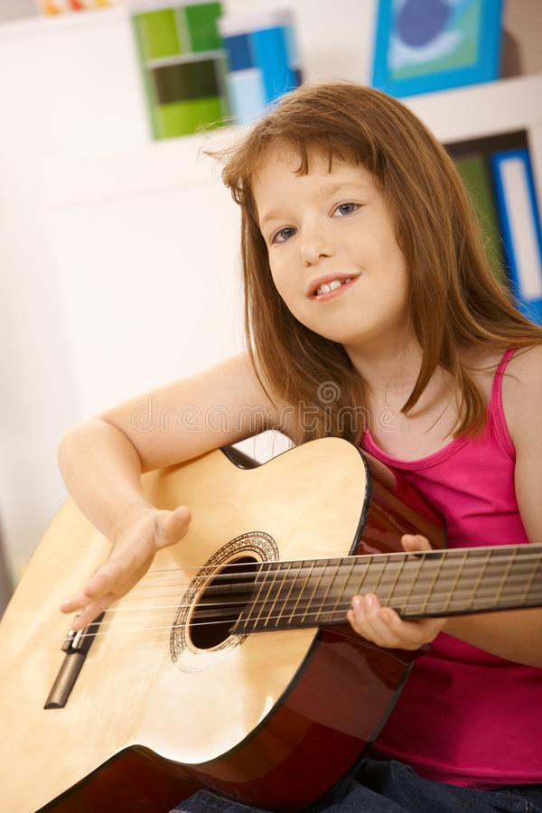 Portrait of little girl with guitar royalty free stock image