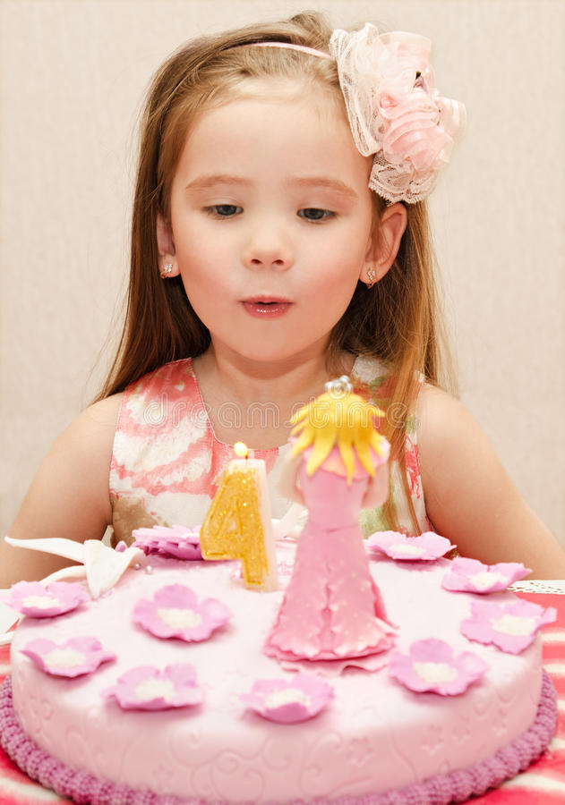 Portrait of little girl and her birthday cake. Portrait of cute little girl and her birthday cake stock photography