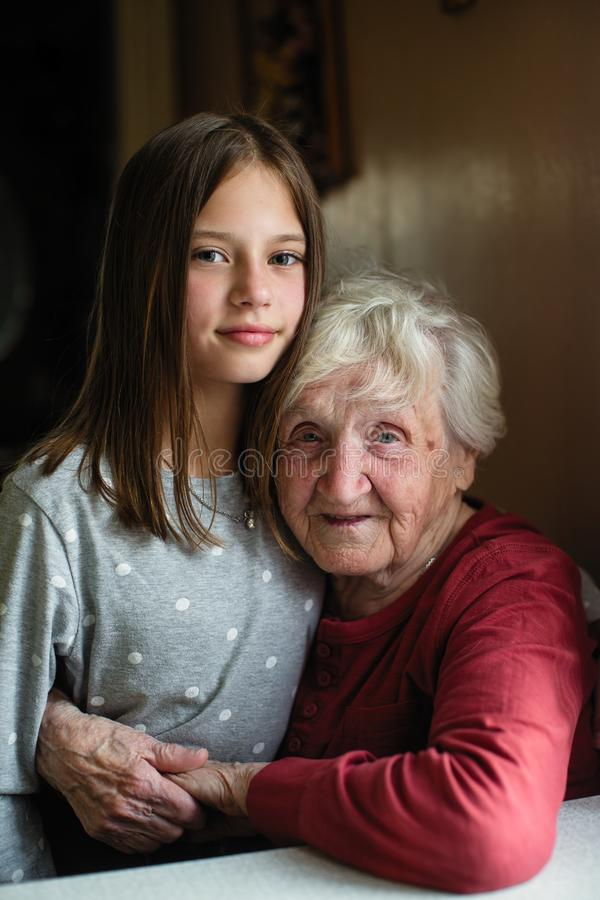 Portrait of little girl and her grandmother. Love. Portrait of little girl and her grandmother stock images