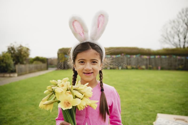 Portrait of a Little Girl Holding Daffodils stock photography