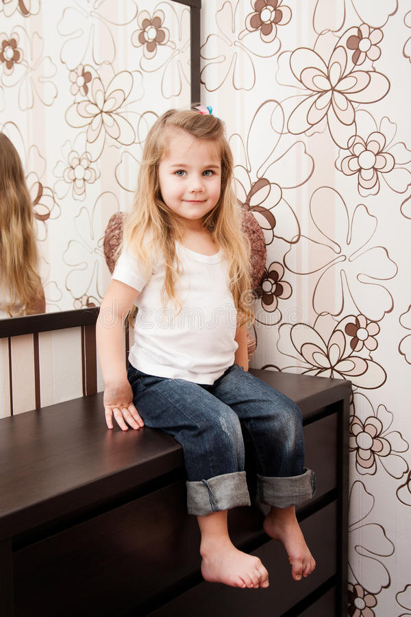 Portrait of a little girl at home. stock image