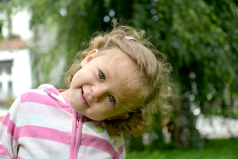 Portrait of the little girl with the inclined head.  stock images