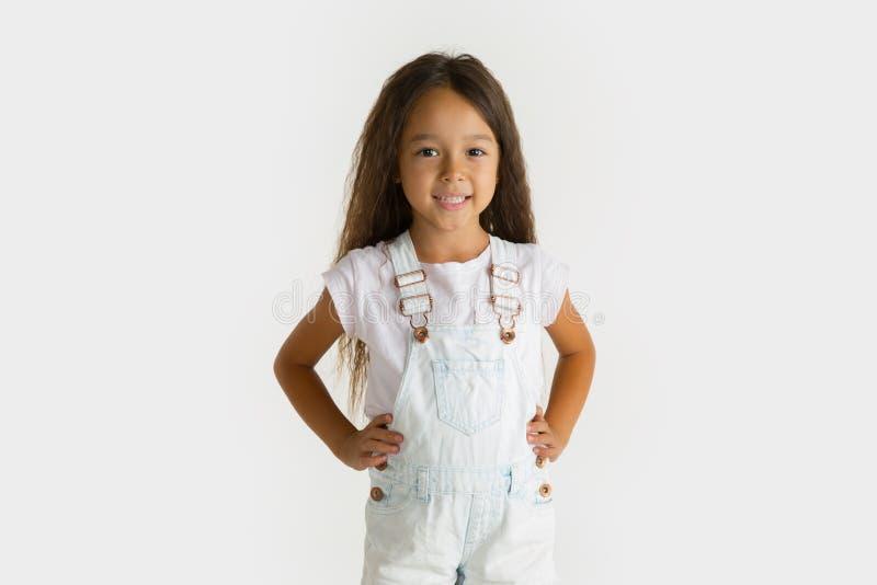 Portrait of little girl isolated on white studio background stock image