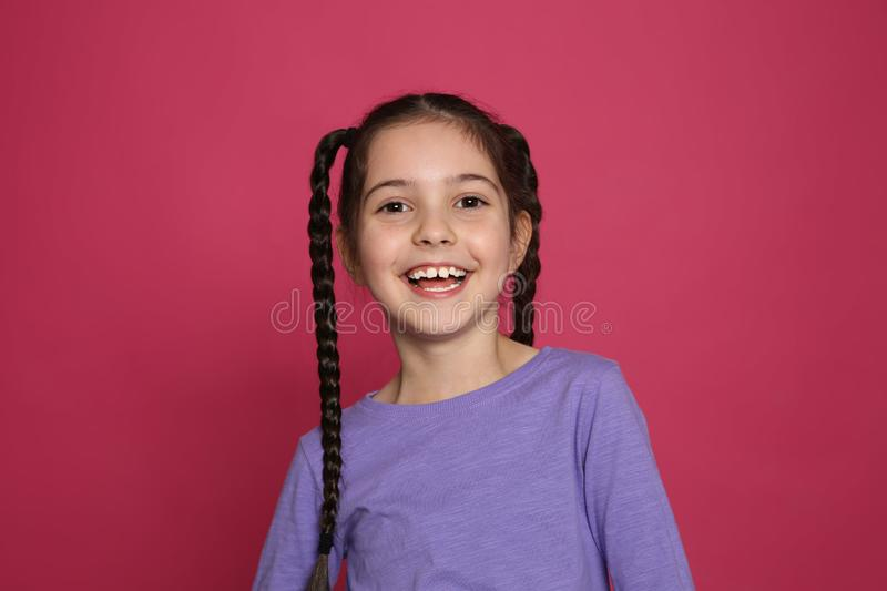Portrait of little girl laughing. On color background royalty free stock photo