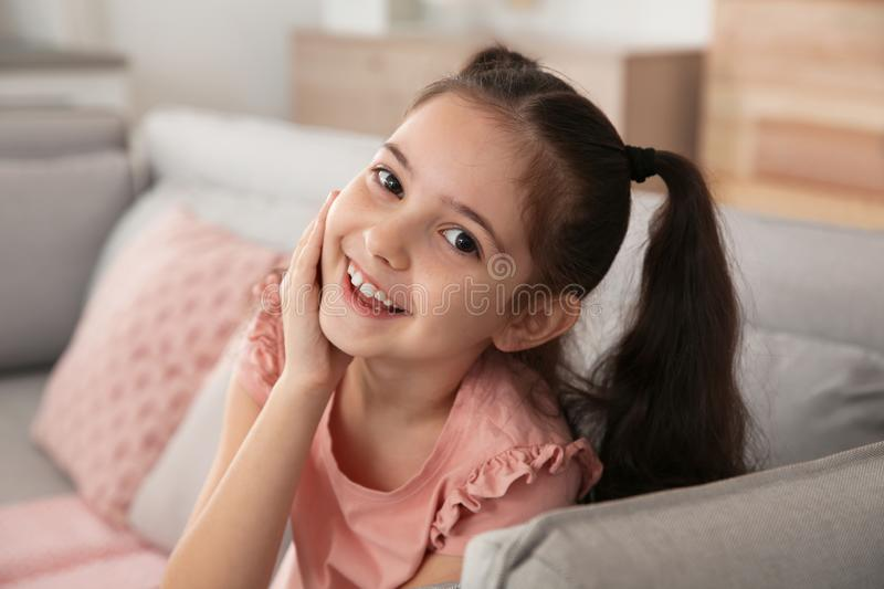 Portrait of little girl laughing. At home royalty free stock images