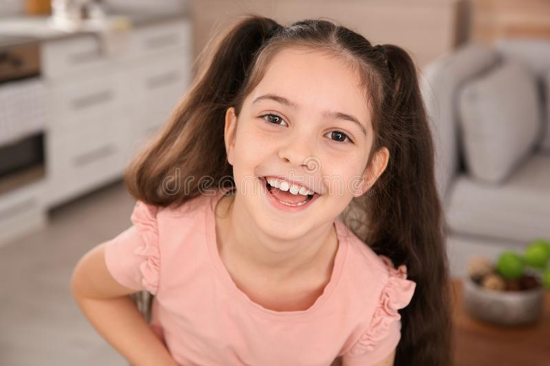 Portrait of little girl laughing. At home stock images