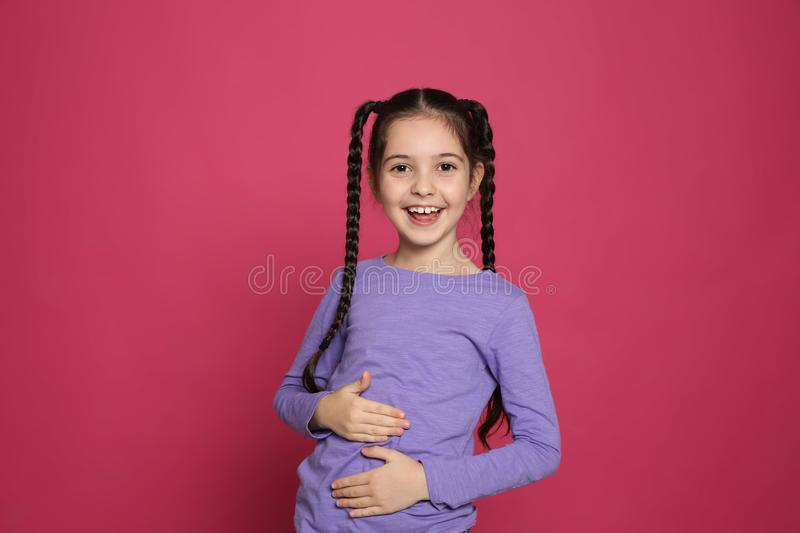 Portrait of little girl laughing royalty free stock photography