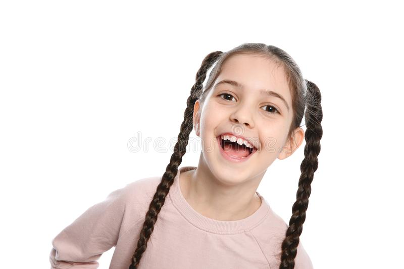 Portrait of little girl laughing on white. Background royalty free stock photo