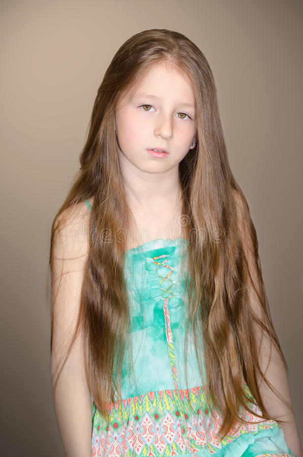 Portrait of the little girl. With long hair stock images