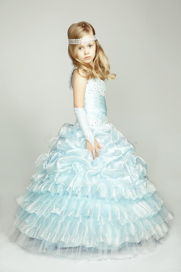 Portrait of little girl in luxurious dress stock images