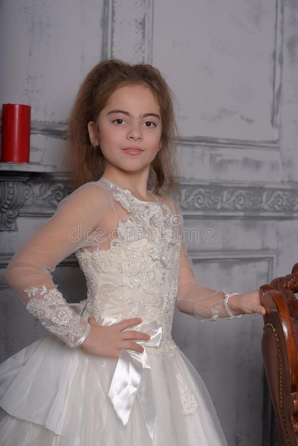Portrait of little girl in luxurious dress stock photography