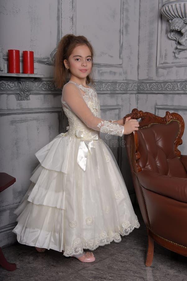Portrait of little girl in luxurious dress stock image