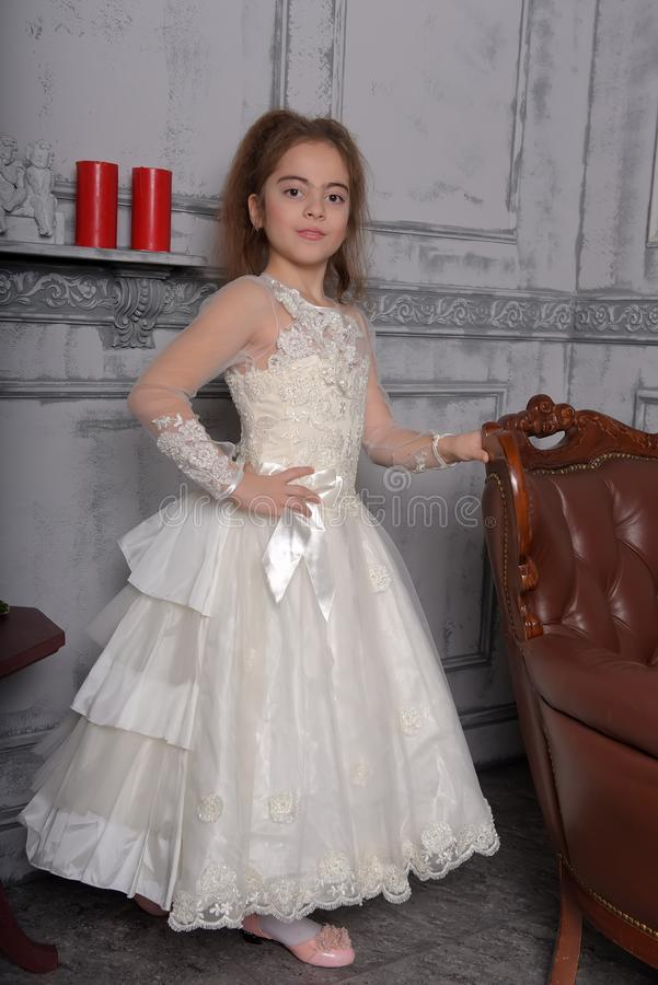 Portrait of little girl in luxurious dress stock photos