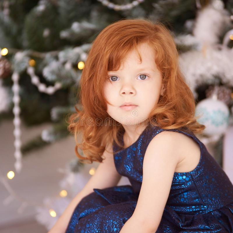 Portrait of little girl. New Year xmas child. Christmas eve holiday. interior. interior. Horizontal royalty free stock photo