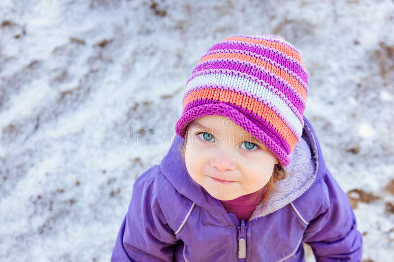 Portrait of little girl one year old looking straight to the camera in winter park. Black and white photo. royalty free stock photography