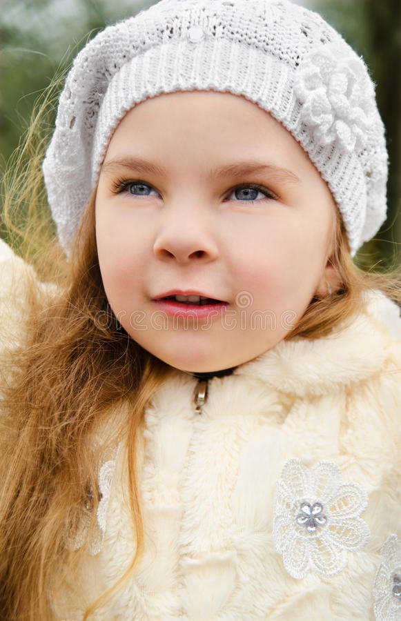 Portrait of little girl outdoors on a spring day royalty free stock photography