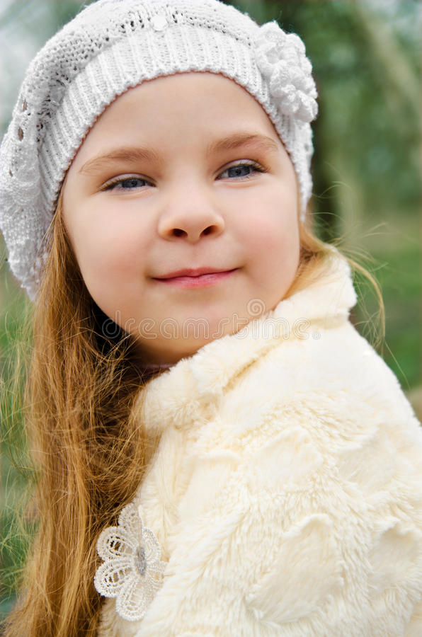 Portrait of little girl outdoors on a spring day stock photo