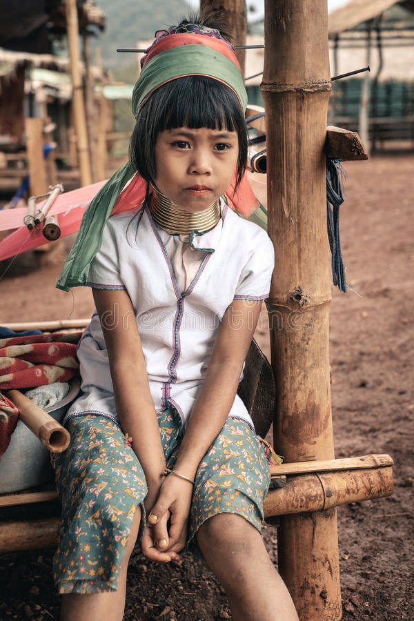 Portrait of little girl from Padaung (Karen) hill tribe. Pan Pet, Myanmar - May 25, 2016: Portrait of little girl from Padaung (Karen) long neck woman in brass royalty free stock photography