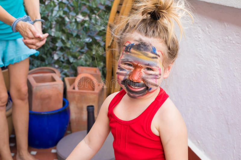 Portrait of little girl with painted face looking stock photos