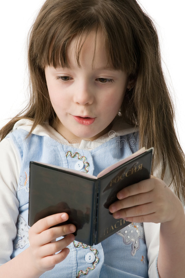 Portrait of little girl with a passport in hands stock images