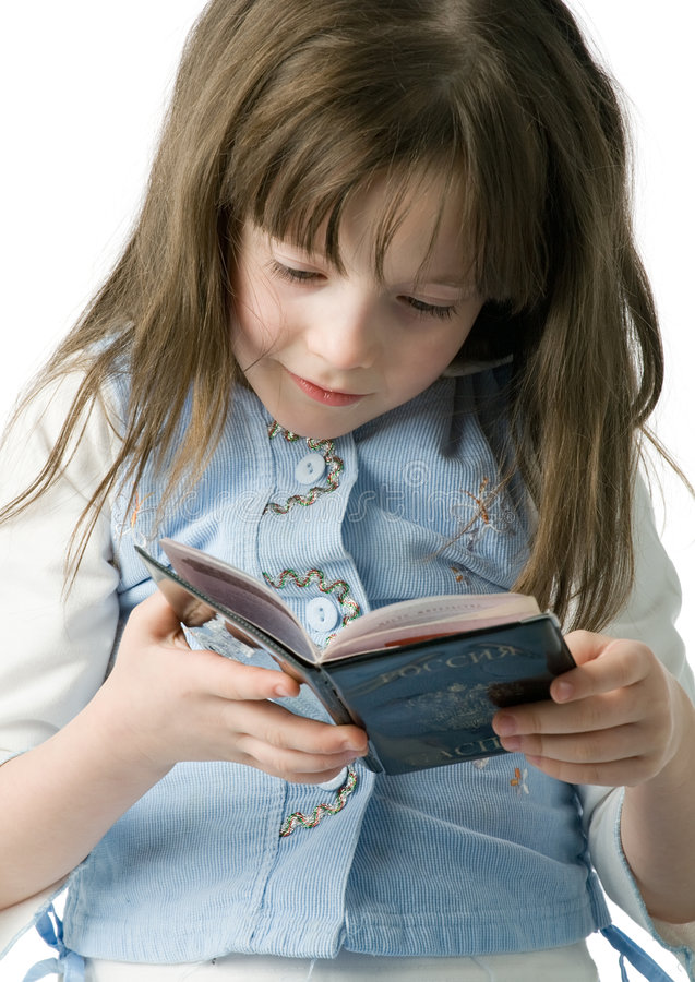 Portrait of little girl with a passport in hands stock photography