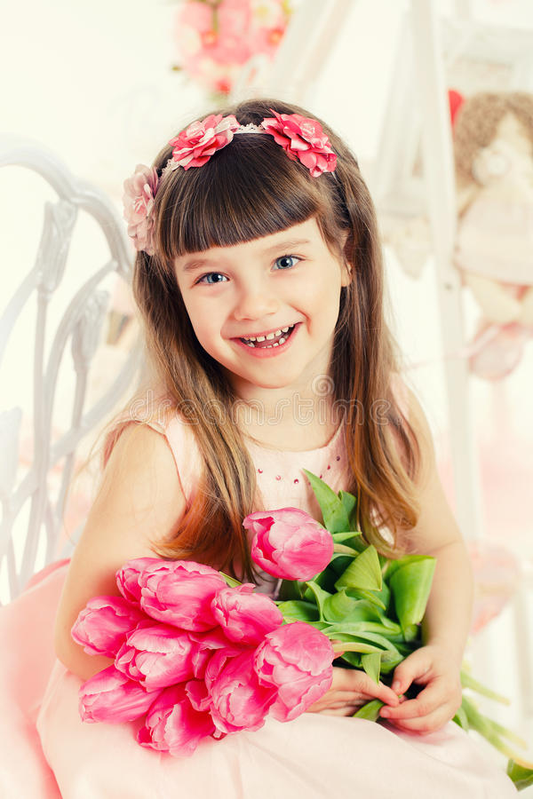 Download Portrait Of A Little Girl, Pink Tulips In Hands Stock Photo - Image: 38779888