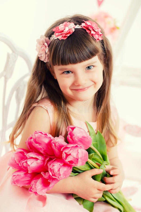 Download Portrait Of A Little Girl, Pink Tulips In Hands Stock Image - Image: 38780021