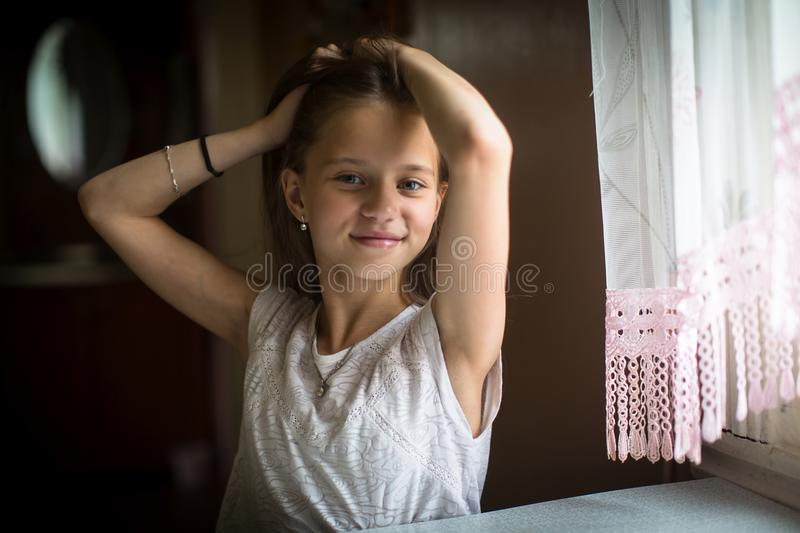 Portrait of little girl posing for the camera. stock image