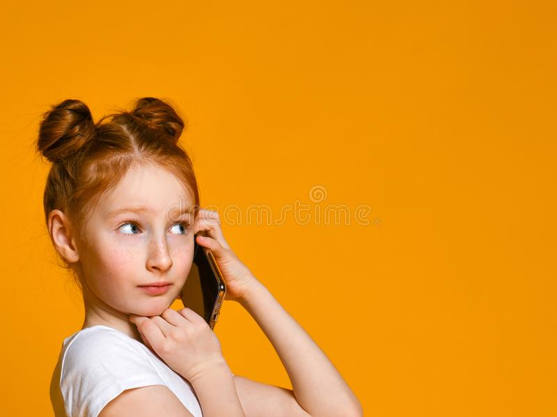 Portrait of the little girl positive that talking on cell phones royalty free stock photo