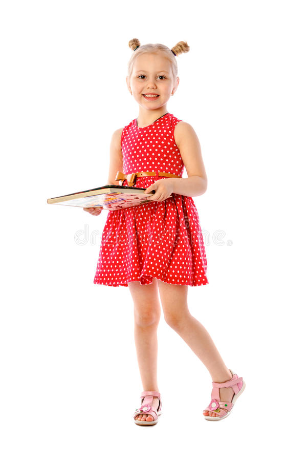 Portrait of a little girl reading books stock image