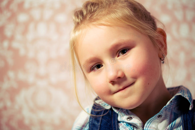 Portrait of little girl before retro background stock image