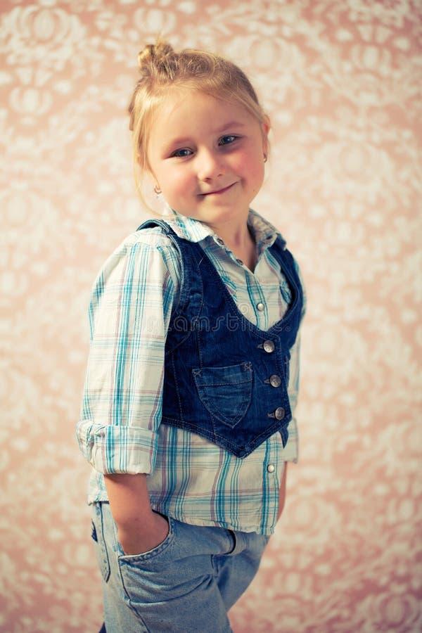 Portrait of little girl before retro background stock photos