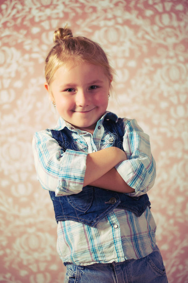 Portrait of little girl before retro background stock images
