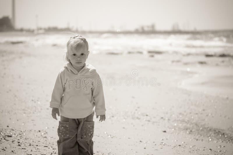 Portrait of little girl on the sea