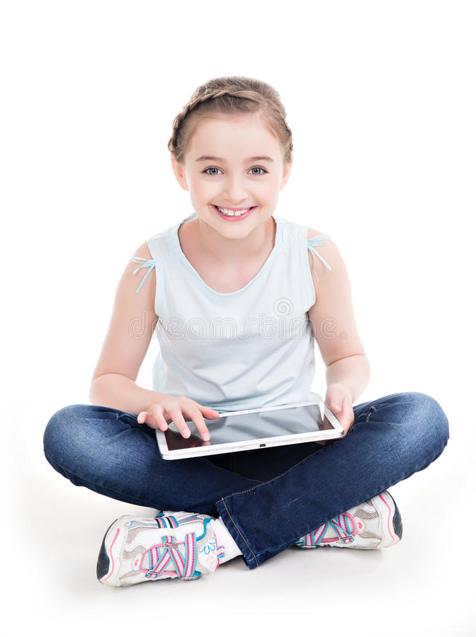 Portrait of little girl sitting with the tablet. Portrait of little girl sitting with the tablet - isolated on white royalty free stock images