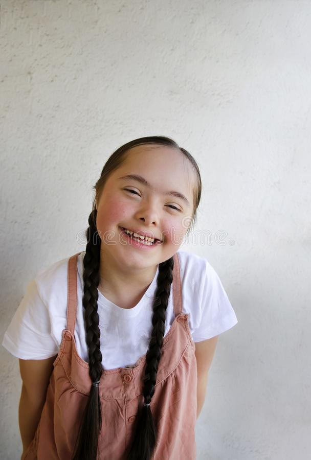 Portrait of little girl smiling on background of the wall stock images