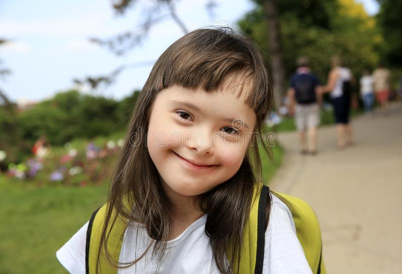Portrait of little girl smiling in the city. Portrait of little girl smiling in the park royalty free stock images