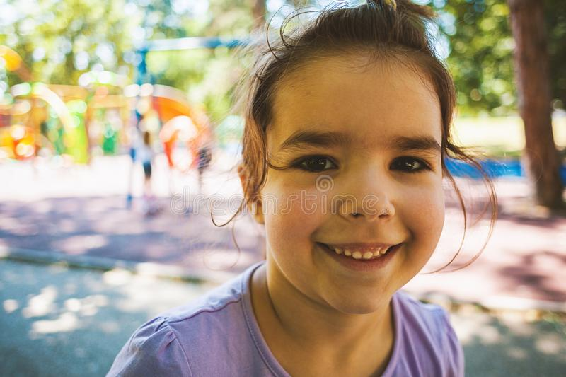 Portrait of a Little Girl in Park royalty free stock photo