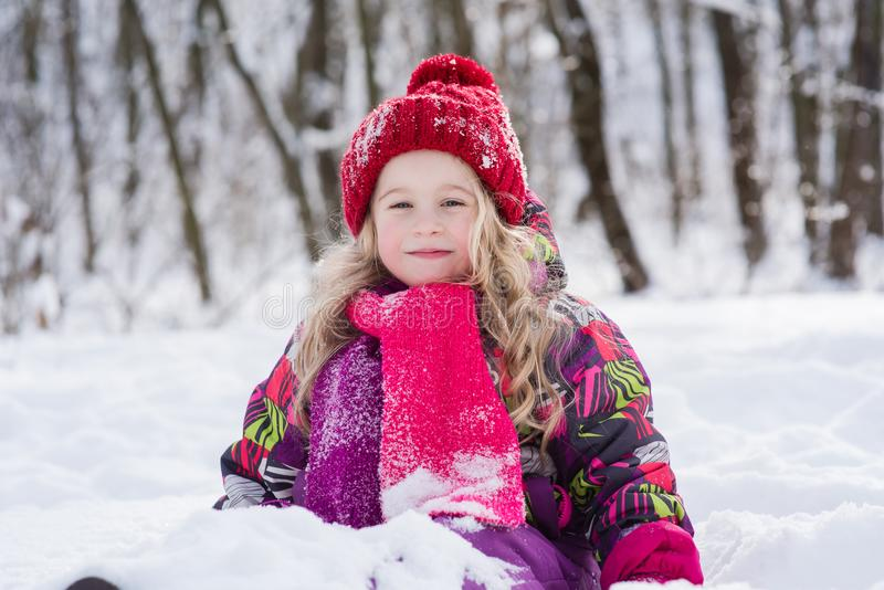 Portrait of a little girl in a snowdrift. stock photo