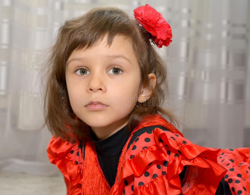 Portrait of the little girl in the Spanish suit.  royalty free stock photos