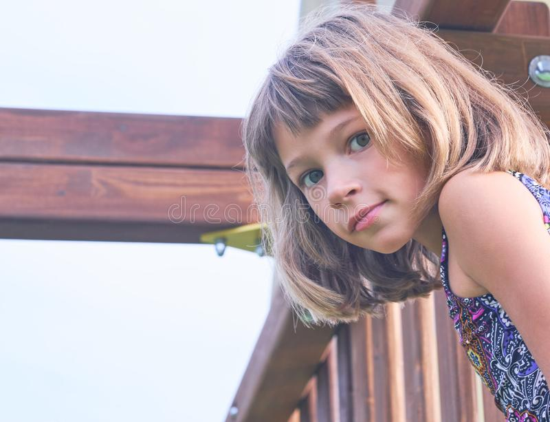 Portrait of little girl in swimsuit on sunny day outside. Concept of summer recreation, travel and enjoy life stock photos